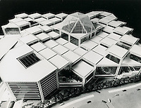 "UNDATED...Norfolk Gardens..MULTI-LEVELED ROOF SUGGESTS VARIETY OF NORFOLK GARDENS..The series of ""space frames"" which compose the roof of Norfolk Gardens cover an interior open space of 80,000,000 cubic feet and a multitude of activities, according to present plans.  Completely enclosed, the 17 acre megastructure will provide an ideal recreational environment in downtown Norfolk....NEG#.NRHA#.."