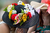 BALTIMORE, MD - MAY 20: Two women in festive hats share a laugh in the grandstands on Preakness Stakes Day at Pimlico Race Course on May 20, 2017 in Baltimore, Maryland.(Photo by Douglas DeFelice/Eclipse Sportswire/Getty Images)