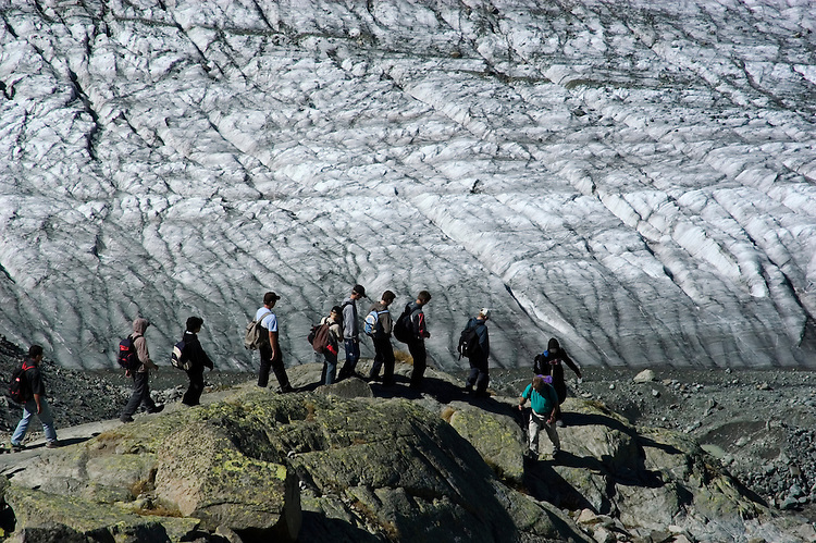 Switzlerland: Hiking the Swiss Glaciers near St. Moritz, taking the Diavolezza Morteratsch hike..Hikers near the Pers Glacier..Photo copyright Lee Foster, 510/549-2202, lee@fostertravel.com, www.fostertravel.com..Photo #: swisse11709