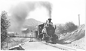 Pilot-end engineer's-side view of RGS #20 crossing the D&amp;RGW junction switch with a nine-car freight as it is coming into the yards.<br /> RGS  Durango, CO  Taken by Kindig, Richard H. - 6/28/1946
