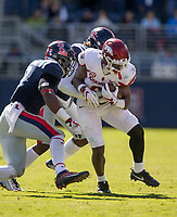 Hawgs Illustrated/BEN GOFF <br /> T.J. Hammonds, Arkansas running back, tries to break the tackle of D.D. Bowie, Ole Miss cornerback, and DeMarquis Gates (left), Ole Miss linebacker, on a run in the third quarter Saturday, Oct. 28, 2017, at Vaught-Hemingway Stadium in Oxford, Miss.
