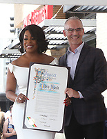 HOLLYWOOD, CA - JULY 11: Niecy Nash, Mitch O'Farrell, at Niecy Nash Honored With Star On The Hollywood Walk Of Fame in Hollywood, California on July 11, 2018. Credit: Faye Sadou/MediaPunch
