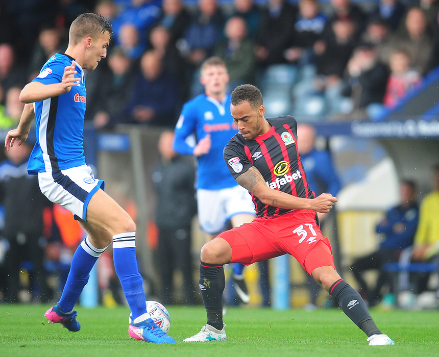 Blackburn Rovers' Elliott Bennett under pressure from Rochdale's Mark Kitching<br /> <br /> Photographer Kevin Barnes/CameraSport<br /> <br /> The EFL Sky Bet League One - Rochdale v Blackburn Rovers - Saturday 9th September 2017 - Spotland Stadium - Rochdale<br /> <br /> World Copyright &copy; 2017 CameraSport. All rights reserved. 43 Linden Ave. Countesthorpe. Leicester. England. LE8 5PG - Tel: +44 (0) 116 277 4147 - admin@camerasport.com - www.camerasport.com