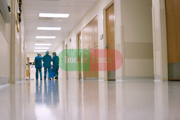 Nurses walk down hallway after surgeries are done..