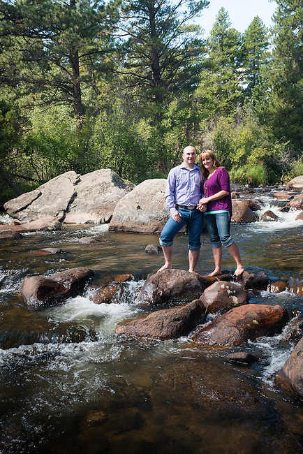 engagement portrait of Julie and Adam along the Big Thompson River on a summer morning in Rocky Mountain National Park, Colorado , USA