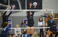 NWA Democrat-Gazette/ANDY SHUPE<br /> Har-Ber's Halle Roberts (25) sends the ball over the net as Fayetteville's Carly Unruh (37) and Lyndsey Mylius defend Wednesday, Sept. 13, 2017, during play in Bulldog Arena. Visit nwadg.com/photos to see more photographs from the match.