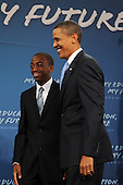 Arlington, VA - September 8, 2009 -- United States President Barack Obama (R) greets Tim Spicer (L), a student at Wakefield High School, before delivering a national address directed to students across the nation, at a back to school event at Wakefield High School in Arlington, Virginia, USA, 08 September 2009.  President Obama delivered remarks to encourage students to study hard, stay in school and take responsibility for their own education on the first day of the school year for many children across America.  .Credit: Michael Reynolds - Pool via CNP