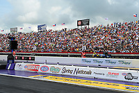 Apr. 29, 2012; Baytown, TX, USA: NHRA fans in the grandstands during the Spring Nationals at Royal Purple Raceway. Mandatory Credit: Mark J. Rebilas-
