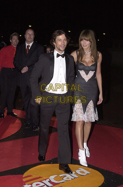 JAY KAY & HEIDI KLUM.Arrivals at the Brit Awards at Earls Court. .Jamiroquai, white ankle boots, fringe, lingerie, lace, full length, full-length.*RAW SCAN - photo will be adjusted for publication*.www.capitalpictures.com.sales@capitalpictures.com.© Capital Pictures