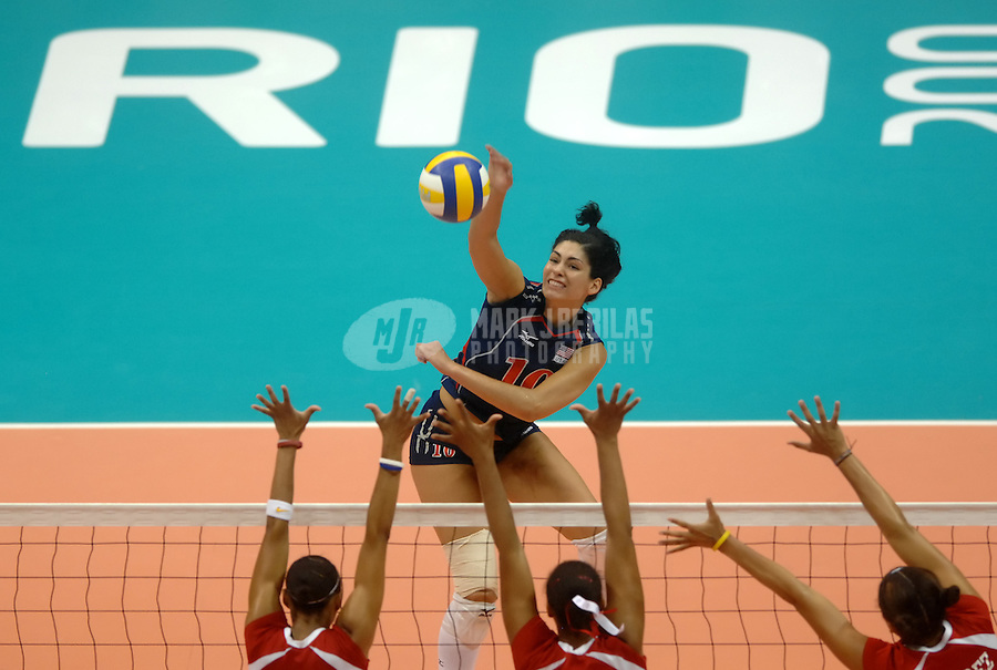 Jul 15, 2007; Rio de Janeiro, Brazil; Cynthia Barboza (USA) spikes the ball against Puerto Rico during the preliminary round of womens volleyball at the Ginasio do Maracanazinho in the Pan American Games at the Multipurpose Arena in Rio de Janeiro. United States defeated Puerto Rico 3-1. Mandatory Credit: Mark J. Rebilas-US PRESSWIRE Copyright © 2007 Mark J. Rebilas