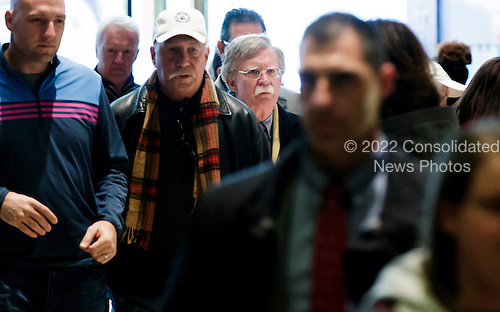 Former United States Ambassador to the United Nations John Bolton (C) walks amongst a crowd of tourists on his way to a meeting with President-elect Donald Trump at Trump Tower in New York, New York, USA, 02 December 2016.<br /> Credit: Justin Lane / Pool via CNP