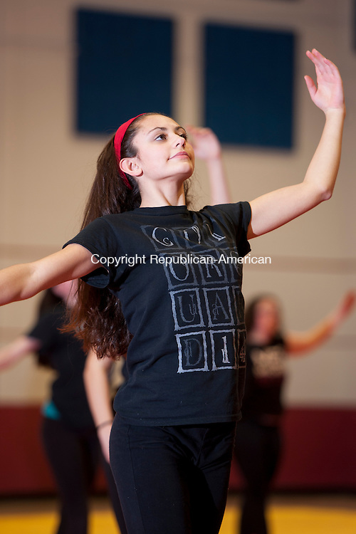 NAUGATUCK, CT-12 February 2015-021215EC10-   Amber Luis, a captain of the winter guard team, practices in the Naugatuck High School gym. Erin Covey Republican-American