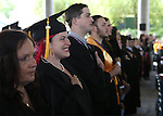Graduates listen to the National Anthem at the 45th annual Western Nevada College Commencement ceremony in Carson City, Nev., on Monday, May 23, 2016. A record 556 graduates received 598 degrees.<br />