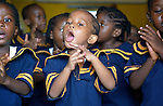 Children sing a song with hand motions during class in a day care center in Monrovia, Liberia, sponsored by United Methodist Women.
