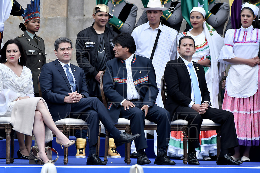BOGOTÁ - COLOMBIA, 07-08-2018: Juan Orlando Hernandez, presidente de Honduras, Evo Morales, presidente de Bolivia, Jimmy Morales, presidente de Guatemala, durante la ceremonia de juramento en donde Ivan Duque, toma posesión como presidente de la República de Colombia para el período constitucional 2018 - 22 en la Plaza Bolívar el 7 de agosto de 2018 en Bogotá, Colombia. / Juan Orlando Hernandez, president of Honduras, Evo Morales, president of Bolivia, Jimmy Morales, president of Guatemala, during the swearing ceremony where Ivan Duque, takes office to constitutional term as president of the Republic of Colombia 2018 - 22 at Plaza Bolivar on August 7, 2018 in Bogota, Colombia. Photo: VizzorImage/ Gabriel Aponte / Staff