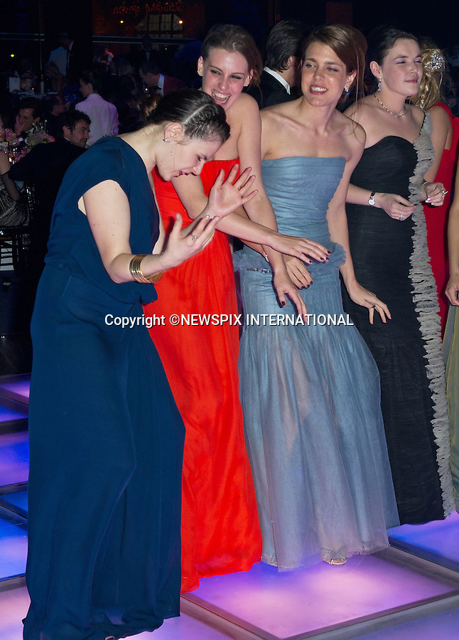"""CHARLOTTE CASIRAGHI.and friends takes to the dance floor at the Bal de la Rose..The theme for this year's Ball that raise funds for the Princess Grace Foundation was """"Swinging London""""_Monte Carlo, 24/03/2012.Mandatory Credit Photos: SBM/Newspix International..**ALL FEES PAYABLE TO: """"NEWSPIX INTERNATIONAL""""**..PHOTO CREDIT MANDATORY!!: NEWSPIX INTERNATIONAL(Failure to credit will incur a surcharge of 100% of reproduction fees)..IMMEDIATE CONFIRMATION OF USAGE REQUIRED:.Newspix International, 31 Chinnery Hill, Bishop's Stortford, ENGLAND CM23 3PS.Tel:+441279 324672  ; Fax: +441279656877.Mobile:  0777568 1153.e-mail: info@newspixinternational.co.uk"""