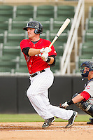 Jeremy Dowdy (23) of the Kannapolis Intimidators follows through on his swing against the Greenville Drive at CMC-Northeast Stadium on June 29, 2013 in Kannapolis, North Carolina.  The Intimidators defeated the Drive 9-3 in the completion of the game that began on June 28, 2013.   (Brian Westerholt/Four Seam Images)