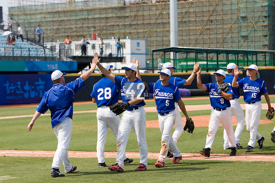 23 August 2007: France's baseball team celebrate after the France 8-4 victory over Czech Republic in the Good Luck Beijing International baseball tournament (olympic test event) at the Wukesong Baseball Field in Beijing, China.