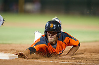 AZL Giants center fielder Nick Hill (22) slides into first on a pick-off attempt during a game against the AZL Angels on July 10, 2017 at Scottsdale Stadium in Scottsdale, Arizona. AZL Giants defeated the AZL Angels 3-2. (Zachary Lucy/Four Seam Images)
