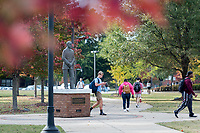 Fall leaves and students on sidewalks near Sonny Montgomery statue.<br />  (photo by Megan Bean / &copy; Mississippi State University)