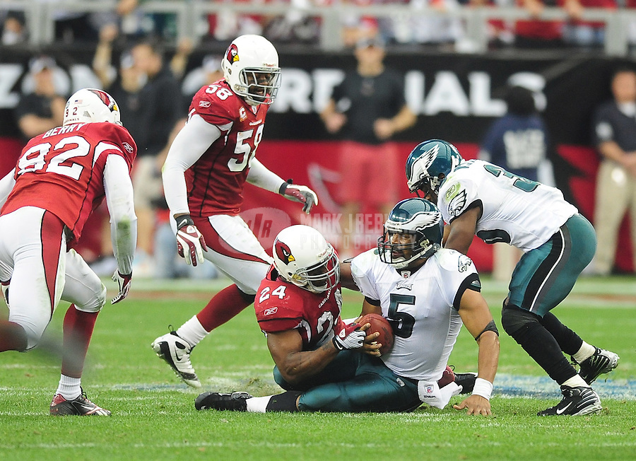 Jan. 18, 2009; Glendale, AZ, USA; Philadelphia Eagles quarterback (5) Donovan McNabb is sacked by Arizona Cardinals safety (24) Adrian Wilson during the NFC Championship game at University of Phoenix Stadium. Arizona defeated the Eagles 32-25 to advance to the Super Bowl. Mandatory Credit: Mark J. Rebilas-
