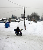 Work of a 60-years old Polish postman Jacek Szczerba in snow covered Piaseczno in central Poland. Jacek is celebrating 40-th anniversary of his work as a postman..January 2010.(Photo by Piotr Malecki / Napo Images)..Praca listonosza. Jacek Serkiew wlasnie obchodzi czterdziestolecie pracy na tym stanowisku. .Piaseczno, Styczen 2010.(Fot: Piotr Malecki / Napo Images) ..