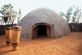 Karrera, Burundi. Traditional reed house with drums outside.