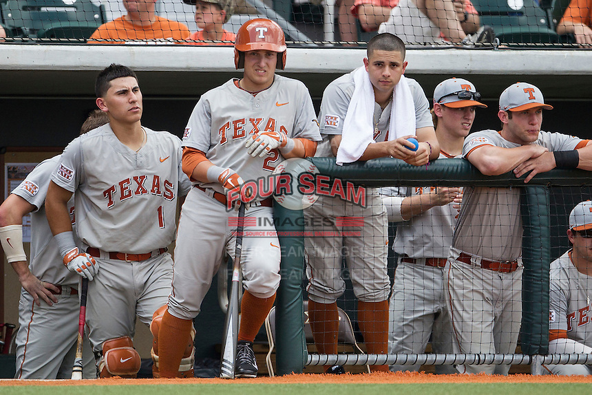 Texas Longhorns Tres Barrera (1), Mark Payton (2) and CJ Hinojosa (9) in the dugout before the NCAA baseball game against the Houston Cougars on June 6, 2014 at UFCU Disch–Falk Field in Austin, Texas. The Longhorns defeated the Cougars 4-2 in Game 1 of the NCAA Super Regional. (Andrew Woolley/Four Seam Images)