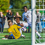 3 October 2015: University of Vermont Catamount Forward Bernard Yeboah, a Junior from Worcester, MA, moves in on Binghamton University Bearcat Goalkeeper Robert Moewes, a Junior from Dortmund, Germany, during game action at Virtue Field in Burlington, Vermont. The Catamounts were unable to complete a late game rally, falling to the Bearcats 2-1 in America East conference play. Mandatory Credit: Ed Wolfstein Photo *** RAW (NEF) Image File Available ***