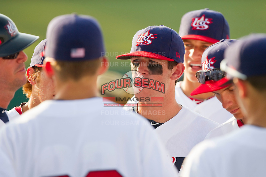 Mikey White #5 of the USA 18u National Team listens to his coach prior to the start of the game against the USA Baseball Collegiate National Team at the USA Baseball National Training Center on July 2, 2011 in Cary, North Carolina.  The College National Team defeated the 18u team 8-1.  Brian Westerholt / Four Seam Images
