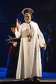 """02/06/2014. London, England. Willard White as Pope Clement VII. Dress rehearsal of the Hector Berlioz opera """"Benvenuto Cellini"""" at the London Coliseum. Directed by Monty Python and movie director Terry Gilliam for the English National Opera. Benvenuto Cellini opens on 5 June for 8 performances. As part of ENO Screen, the opera will be broadcast live to over 300 cinemas in the UK and Ireland and selected cinemas worldwide on 17 June 2014. Co-production with De Nederlandse Opera, Amsterdam and Teatro dell'Opera di Roma. Michael Spyres as Benvenuto Cellini, Pavlo Hunka as Balducci, Corinne Winters as Teresa, Nicholas Pallesen as Fieramosca and Willard White as Pope Clement VII. Photo credit: Bettina Strenske"""