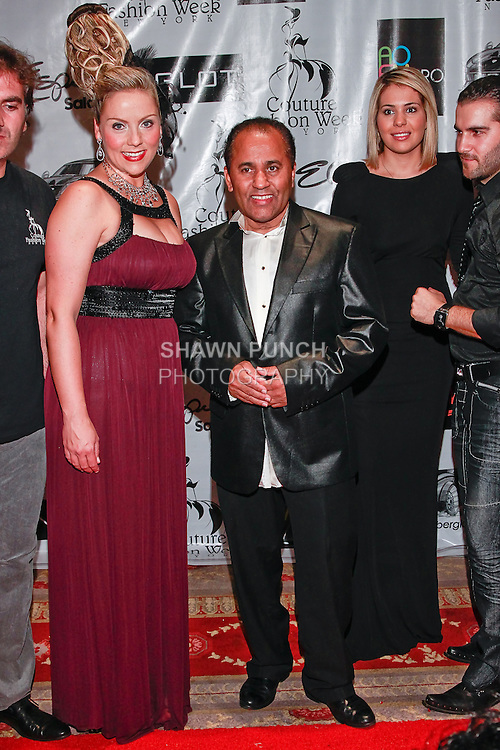 Soprano singer Christine Reber poses on red carpet with fashion producer Andres Aquino (center), guest, and Elie Esper (far right) during Couture Fashion Week Spring 2012, at the Waldorf Astoria-Hotel in New York City.