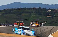 May 17, 2009: The #01 Lexus Riley of Scott Pruett and Memo Rojas leads a pack of cars at  the Verizon Festival of Speed Grand-Am Rolex Series race at LMazda Raceway at Laguna Seca  in Salinas, CA (Photo by Brian Cleary/www.bcpix.com)