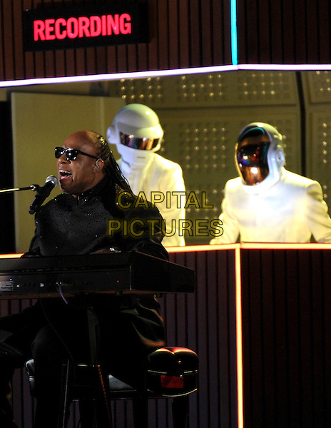 LOS ANGELES, CA - JANUARY 26 : Stevie Wonder (R) and Guy-Manuel de Homem-Christo and Thomas Bangalter of 'Daft Punk' perform onstage at The 56th Annual GRAMMY Awards at Staples Center on January 26, 2014 in Los Angeles, California.<br /> CAP/MPI/PG<br /> &copy;PGFMicelotta/MediaPunch/Capital Pictures