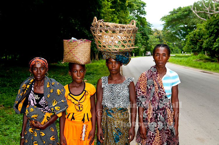 Local Malagasy women stop and pose for a photo whilst on their way to the markets. Ambanja - Northern Madagascar.