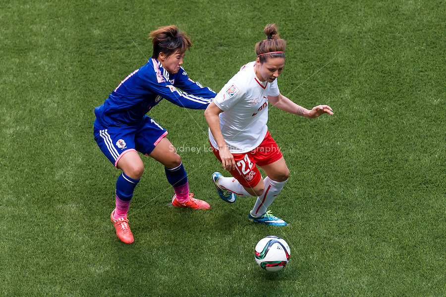 June 8, 2015: Vanessa BERNAUER of Switzerland protects the ball during a Group C match at the FIFA Women's World Cup Canada 2015 between Japan and Switzerland at BC Place Stadium on 8 June 2015 in Vancouver, Canada. Sydney Low/AsteriskImages