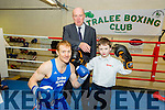 Ben Hickey has a 'Spar' with Tralee Boxing Club Chairman  Bryan O'Sullivan with Gerry Dwyer, Lee-Strand as referee at the Launch of Katie Taylor V Queen Underwood boxing event in the Brandon Conference Centre, Tralee on Saturday 20th February