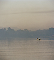 Local rowing a papyrus reed boat, otherwise known as a Tankwa, Lake Tana, North West Ethiopia