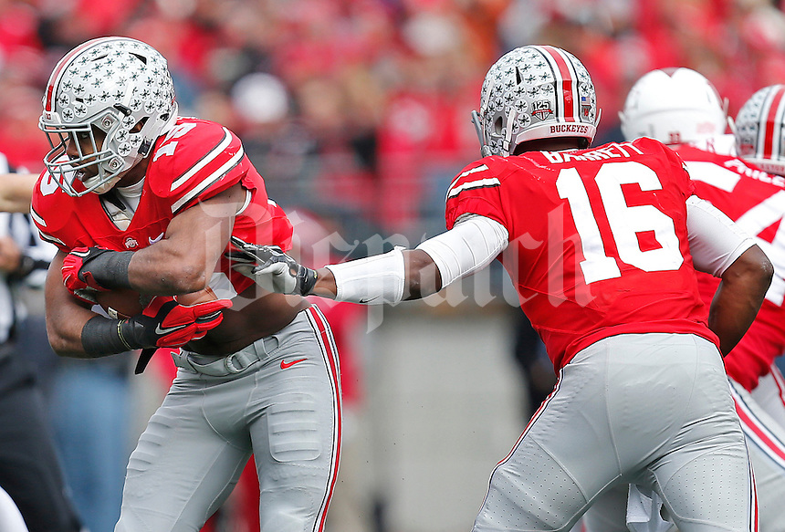Ohio State Buckeyes quarterback J.T. Barrett (16) hands off to Ohio State Buckeyes running back Ezekiel Elliott (15) during the college football game between the Ohio State Buckeyes and the Indiana Hoosiers at Ohio Stadium in Columbus, Saturday afternoon, November 22, 2014. The Ohio State Buckeyes defeated the Indiana Hoosiers 42 - 27. (The Columbus Dispatch / Eamon Queeney)