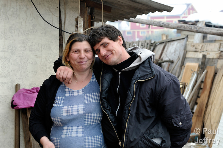 Giltena Duda and her husband Ismet Sabanaj live in the Zemun Polje Roma neighborhood of Belgrade, Serbia. Ms. Duda is pregnant with her seventh child. They are Roma refugees from Kosovo, and thus legally marginalized in Serbia. They built their home on unregistered land and pirate their electrical hookup. Without legal residency, their children can't attend a regular school, and they have difficulties getting formal employment. Yet both participate in an adult literacy program sponsored by the Branko Pesic School, where their children attend classes. The school is supported by Church World Service.