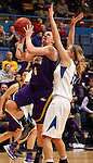 SIOUX FALLS, SD - MARCH 10:  Michelle Maher #14 from Western Illinois takes the ball to the basket against Erin Murphy #12 from IPFW in the second half of their quarterfinal game Sunday afternoon at the 2013 Summit League Championships in Sioux Falls, SD.  (Photo by Dave Eggen/Inertia)