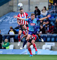 Lincoln City's Jason Shackell battles with Wycombe Wanderers' David Wheeler<br /> <br /> Photographer Andrew Vaughan/CameraSport<br /> <br /> The EFL Sky Bet League One - Wycombe Wanderers v Lincoln City - Saturday 7th September 2019 - Adams Park - Wycombe<br /> <br /> World Copyright © 2019 CameraSport. All rights reserved. 43 Linden Ave. Countesthorpe. Leicester. England. LE8 5PG - Tel: +44 (0) 116 277 4147 - admin@camerasport.com - www.camerasport.com