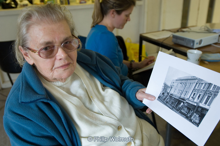 Rhoda Remington (91) with a photograph of a now closed branch of Marks & Spencers on the Harrow Road. Open Age reminiscence session at the WECH Community Centre