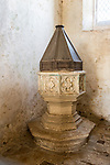 Building interior medieval church architectural feature, Inglesham, Wiltshire, England ancient baptismal christening font