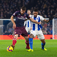 Brighton & Hove Albion's Jurgen Locadia (right) battles with Arsenal's Sokratis Papastathopoulos (left)  <br /> <br /> Photographer David Horton/CameraSport<br /> <br /> The Premier League - Brighton and Hove Albion v Arsenal - Wednesday 26th December 2018 - The Amex Stadium - Brighton<br /> <br /> World Copyright © 2018 CameraSport. All rights reserved. 43 Linden Ave. Countesthorpe. Leicester. England. LE8 5PG - Tel: +44 (0) 116 277 4147 - admin@camerasport.com - www.camerasport.com