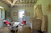 A French inspired girl's bedroom with a canopied daybed