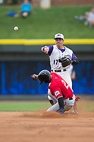 Danny Mendick (17) of the Winston-Salem Dash makes a throw to first base after forcing out Corey Ray (2) of the Carolina Mudcats at second base at BB&T Ballpark on May 21, 2017 in Winston-Salem, North Carolina.  The Mudcats defeated the Dash 3-0 in 10 innings.  (Brian Westerholt/Four Seam Images)