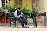 A man rests with his dog in a Madrid garden during the health crisis due to the Covid-19 virus pandemic - Coronaviruss. April 30,2020. (ALTERPHOTOS/Alejandro de Dios)