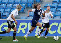 USA's Alex Morgan fights for the ball with Germany's Anja Mittag during their Algarve Women's Cup soccer match at Algarve stadium in Faro, March 13, 2013.  .