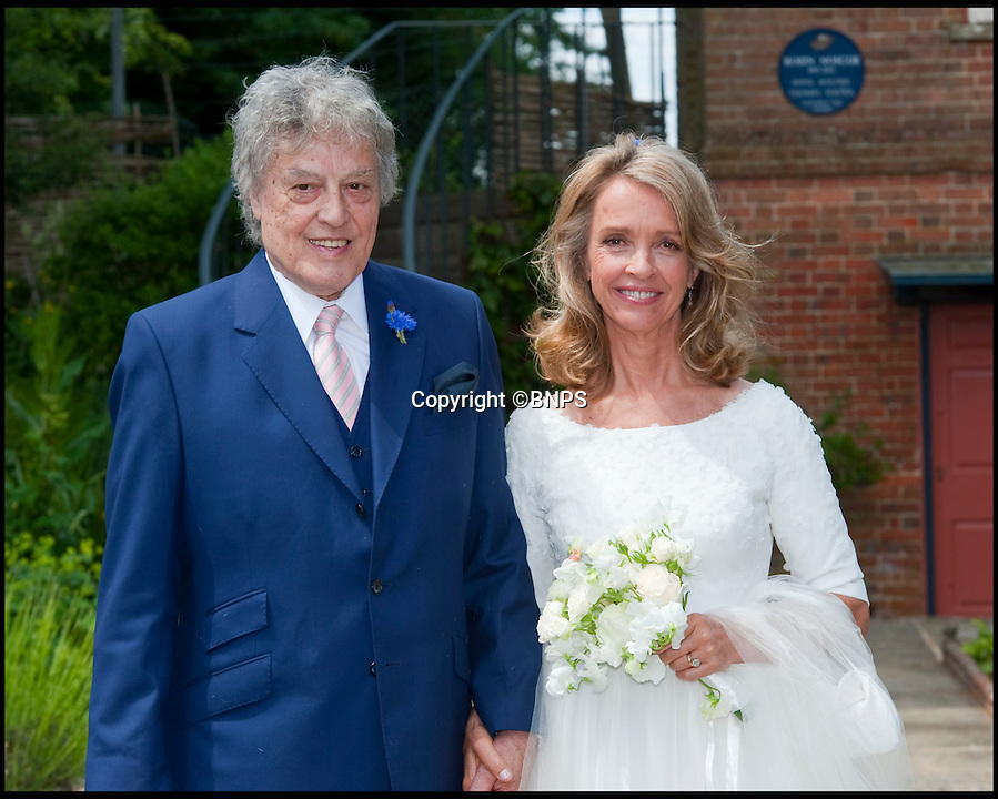 BNPS.co.uk (01202 558833)<br /> Pic: PhilYeomans/BNPS<br /> <br /> Playwright Sir Tom Stoppard tied the knot with brewery heiress Sabrina Guinness in an intimate registry office ceremony today.<br /> <br /> The 76-year-old father-of-four, regarded as Britain's greatest living playwright, wed Miss Guinness, 58, in the picturesque Dorset town of Wimborne.<br /> <br /> It is the third time Sir Tom has married but the first for Miss Guinness, who counts Prince Charles and Mick Jagger among her past suitors.<br /> <br /> The couple arrived at the registry office, Wimborne Town Council's council chamber, in a luxury silver Mercedes E-class car ahead of the midday ceremony.<br /> <br /> Sir Tom wore a navy blue suit with a salmon pink striped tie while Miss Guinness wore a white wedding dress.<br /> <br /> The understated service was conducted by a local registrar in front of a small congregation of 40 close friends and family.<br /> <br /> Guests included Sir Tom's sons Ed, an actor, Oliver, Barnaby and William, and Zac Goldsmith, MP for Richmond Park.<br /> <br /> Rose petals were thrown over the couple as they emerged from the registry office's small side door to the cheers of the guests.<br /> <br /> Following the service the newlyweds returned to their plush country pad in nearby village Tarrant Gunville for a lavish reception.